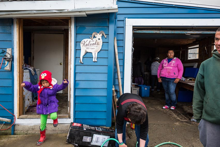 Family and community members gather at the house of Joe Kaleak for a feast celebrating Kaktovik's first whale of the year.