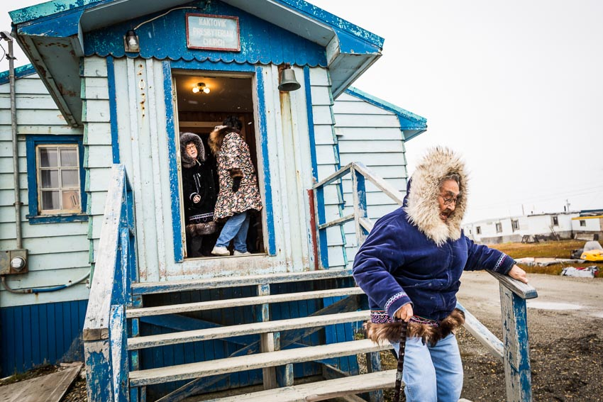 Issac Akootchook, 90 years old, walks home after church in Kaktovik.